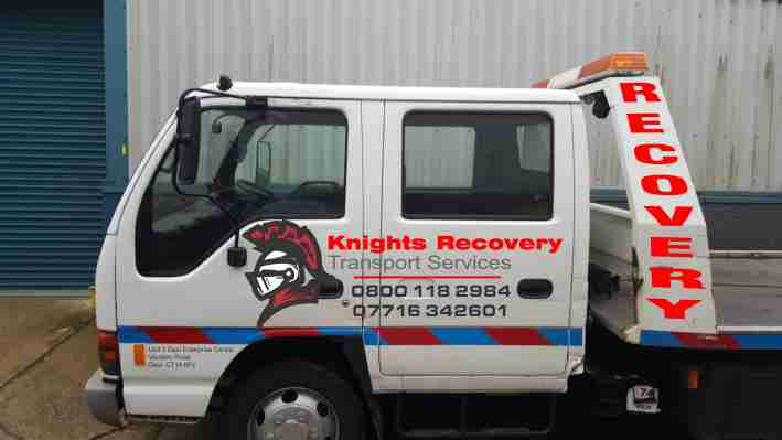 logo on a recovery truck